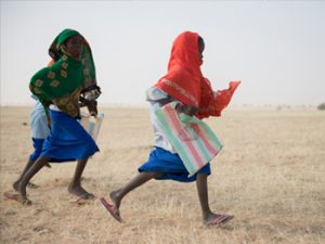 kids-running-to-get-to-school